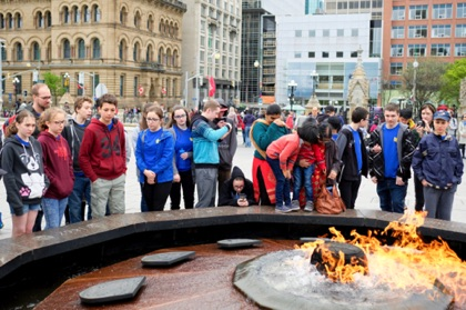 There were many tourist groups present for the weekend festival. This school group is fascinated by the Centennial Flame.