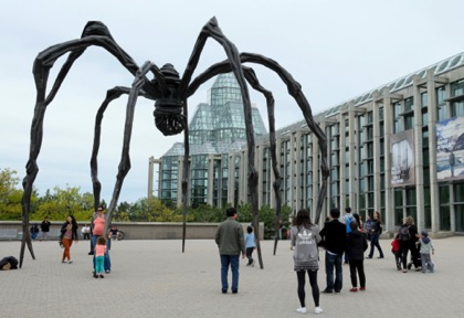 A remarkable statue of a spider titled 'Maman' in front of the National Gallery of Canada. She ('Mommy' in English) is holding eggs under her body.